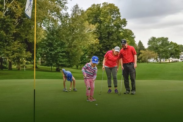 Quit Qui Oc Golf Course and Restaurant Family Golfing together helping kids put