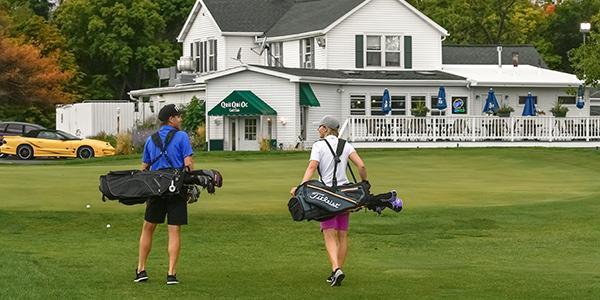 Quit Qui Oc Golf Course and Restaurant Couples Golfing